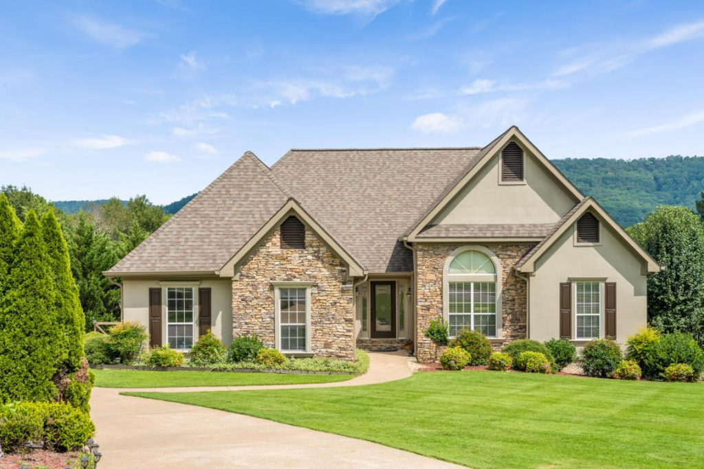 Situated in Ooltewah's Windstone Subdivision, this home welcomes you with a spacious lawn and pristine landscape. A cathedral ceiling and gleaming hardwood floors greet you at the door. The luxuriously detailed crown molding flows through the main living spaces.