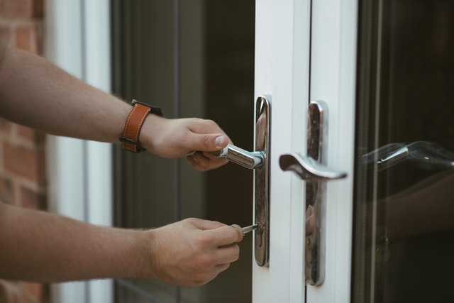 A New Homeowner Opening the Door of Their New Residence